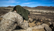 A Marine with 1st Battalion, 8th Marine Regiment observes snipers engaging targets during the sniper marksmanship assessment as part of Integrated Training Exercise 1-16 aboard Marine Air Ground Combat Center, Twentynine Palms, Calif., Oct. 24, 2015. During ITX, Marines demonstrate core infantry mission essential tasks while conducting offensive and defensive stability operations. (U.S. Marine Corps photo by Cpl. Immanuel M. Johnson/Released)