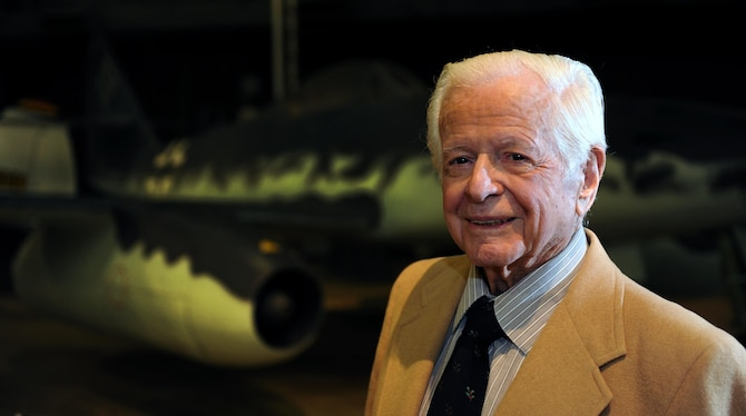 Victor Bilek, a National Air and Space Intelligence Center alum, stands in front of the German Messerschmitt Me 262 Schwalbe Wednesday, Dec. 9, 2015 at the National Air Force Museum. He worked on the exploitation of the plane's armament systems during WWII. At 97 years old, Bilek is the oldest living NASIC alum. He recently came to the Center to share his war stories with today's generation of Airmen. (U.S. Air Force photo by Tech. Sgt. Raymond Hoy)