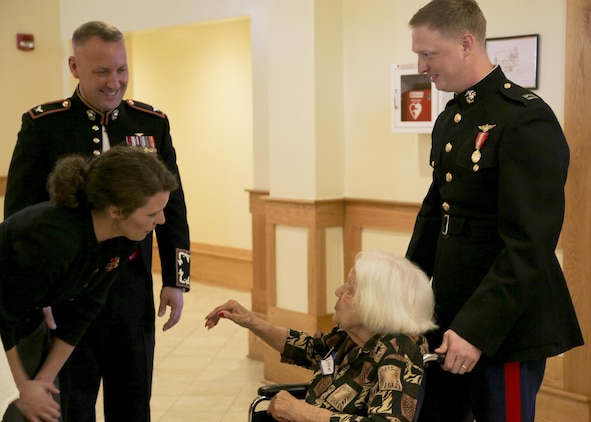 Col. Peter Buck and wife Pamela Buck, left, greet a guest to the 46th Annual Senior Tea aboard Marine Corps Air Station Beaufort Dec. 13. Officers escorted the senior citizens to their seats to enjoy refreshments and entertainment. The event was made possible by the Officers' Spouses' Club, volunteers, and Marines with Headquarters and Headquarters Squadron, and Marine Aircraft Group 31, and Marine Corps Air Station Beaufort. Buck is the commanding officer of MCAS Beaufort.
