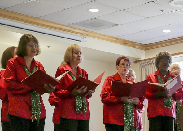 The Beaufort Belles sing at the 46th Annual Senior Tea aboard Marine Corps Air Station Beaufort Dec. 13. The group performed an arrangement of Christmas music to the crowd. The Beaufort Belles, directed by Cindy Valieant, are a barbershop singing group comprised of about 18 members from the Beaufort area.