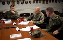 (left) BGen J.D. Alford, CG MCWL/FD, (center) Gen Robert Neller, CMC, and (right) LtGen Robert Walsh, CG MCCDC talk about the Marine Corps' current plan for wargaming and considerations for the future.
