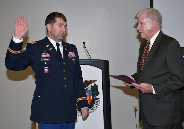 (Right) Society of American Military Engineers Nashville Post member John Hall, administers the oath of office to incoming SAME President Lt. Col. Stephen F. Murphy, Nashville District commander during an installation ceremony in the Tennessee Engineering Center at the Adventure Science Center.