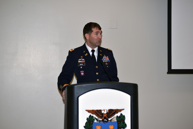Lt. Col. Stephen F. Murphy, Nashville District commander, accepts the position of President of the Society of American Military Engineers Nashville Post during an installation ceremony in the Tennessee Engineering Center at the Adventure Science Center Dec. 16, 2015.