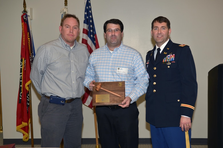 Christopher Green (Left), vice president of the SAME Nashville Post, and Lt. Col. Stephen F. Murphy (Right), U.S. Army Corps of Engineers Nashville District commander, presents outgoing President Mark Luskin a plaque after Murphy's installation as president during a meeting Dec. 16, 2015 in the Tennessee Engineering Center at the Adventure Science Center in Nashville, Tenn.