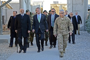U.S. Defense Secretary Ash Carter, center, walks with Afghan Defense Minister Masoom Stanekzai, front left, and U.S. Army Gen. John F. Campbell, right, commander of NATO's Resolute Support mission and U.S. Forces – Afghanistan, while visiting Forward Operating Base Fenty in Jalalabad, Afghanistan, Dec. 18, 2015. Carter is on a weeklong trip to the Middle East to meet with defense leaders and thank U.S. and coalition troops for their service and sacrifice, especially during the holiday season. U.S. Air Force photo by Staff Sgt. Tony Coronado
