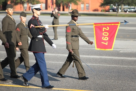 Pfc. Ryan B. Hall, the Honor Graduate of platoon 2097, marches across the parade deck during the pass and review portion of the graduation Dec. 18, 2015, at Marine Corps Depot Parris Island, S.C. Louangrath, a native of Cedar Parks, Tx, was recruited by Staff Sgt. Jesse T. Cody out of Recruiting Station Montgomery. (Official Marine Corps photo by Cpl. Diamond N. Peden/Released)