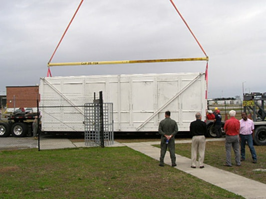 Reusable simulator containers are prepped for shipment from Cherry Point to Norfolk in December.