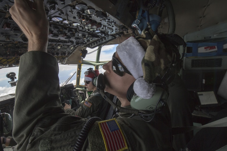 Staff Sgt. Travis Livingston, 36th Airlift Squadron flight engineer, checks instruments over the Pacific Ocean, Dec. 11, 2015, during Operation Christmas Drop. Every December, C-130H Hercules aircrews from Yokota head to Andersen Air Force Base to execute low-cost, low-altitude humanitarian airdrops to islanders throughout the Commonwealth of the Northern Marianas, Federated States of Micronesia, Republic of Palau. These islands are some of the most remote locations on the globe spanning a distance nearly as broad as the continental U.S. It is the longest-running Department of Defense humanitarian airdrop operation with 2015 being the first trilateral execution with support from Japan Air Self-Defense Force and Royal Australian Air Force. (U.S. Air Force photo by Osakabe Yasuo/Released)