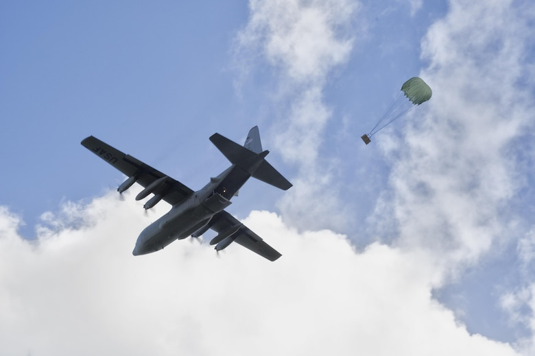A C-130 Hercules assigned to the 36th Airlift Squadron drops a bundles during Operation Christmas Drop 2015, at Fais Island, Federated States of Micronesia, Dec. 8, 2015. Airmen delivered over 800 pounds of supplies to the island of Fais during Operation Christmas Drop 2015. This year marks the first trilateral Operation Christmas Drop where the U.S. Air Force, Japan Air Self-Defense Force and the Royal Australian Air Force work together to provide critical supplies to 56 Micronesian islands. (U.S. Air Force photo by Osakabe Yasuo/Released)