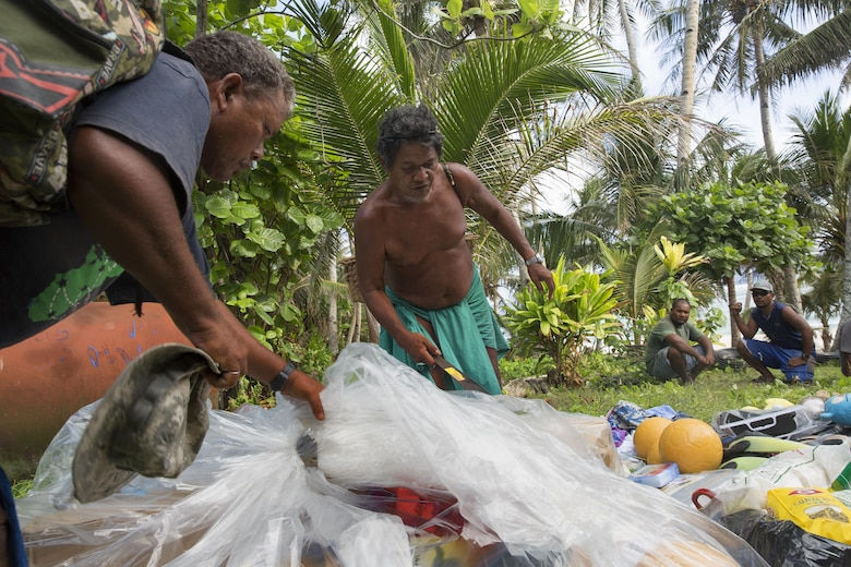 Louis Mangtau, Chief of Fais Island, sorts through supplies that were dropped during Operation Christmas Drop 2015, Dec. 8, 2015, at Fais Island, Federated States of Micronesia. Operation Christmas Drop is a humanitarian/disaster relief training event where C-130 crews provide critical supplies to 56 islands throughout the Commonwealth of the Northern Marianas, Federated States of Micronesia and Republic of Palau. This year marks the first ever trilateral execution that includes air support from the U.S. Air Force, Japan Air Self-Defense Force and the Royal Australian Air Force. (U.S. Air Force photo by Osakabe Yasuo/Released)