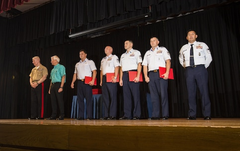 Lt. Gen. John A. Toolan, commander, U.S. Marine Corps Forces, Pacific and Mayor Kirk Caldwell, City & County of Honolulu, award U.S. Airmen during the First Responder Recognition Ceremony at the Neal S. Blaisdell Center, in Honolulu, Dec. 18, 2015.  Military and civilian personnel that selflessly assisted during the rescue and treatment of the Marines and Sailor received recognition from the U.S. Marine Corps Forces, Pacific Commander.