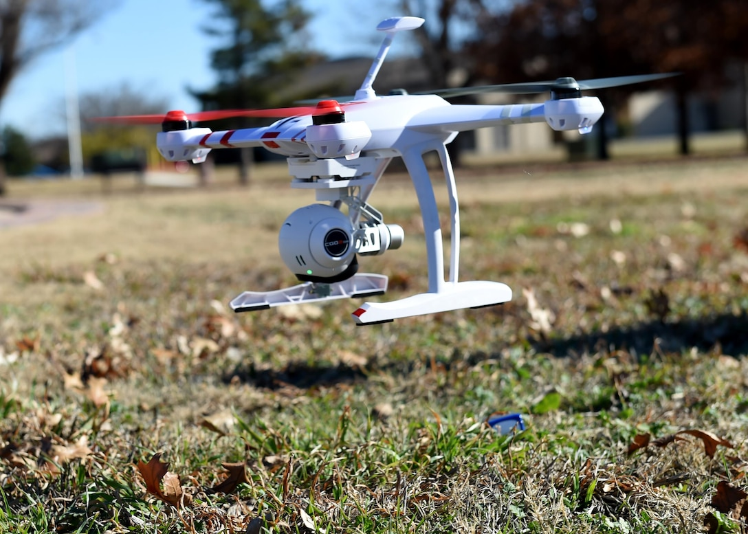 A drone is flown to demonstrate how it is used for official purposes at Wings of Freedom Park, Dec. 15, 2015. With the increase of drones' popularity in the last few years, laws restricting the use of drones within 5 miles of an airbase have been made but some exceptions are made for official tasks such as checking roofs and showing cleared roadways on base. (U.S. Air Force photo by Airman 1st Class Kirby Turbak/Released)