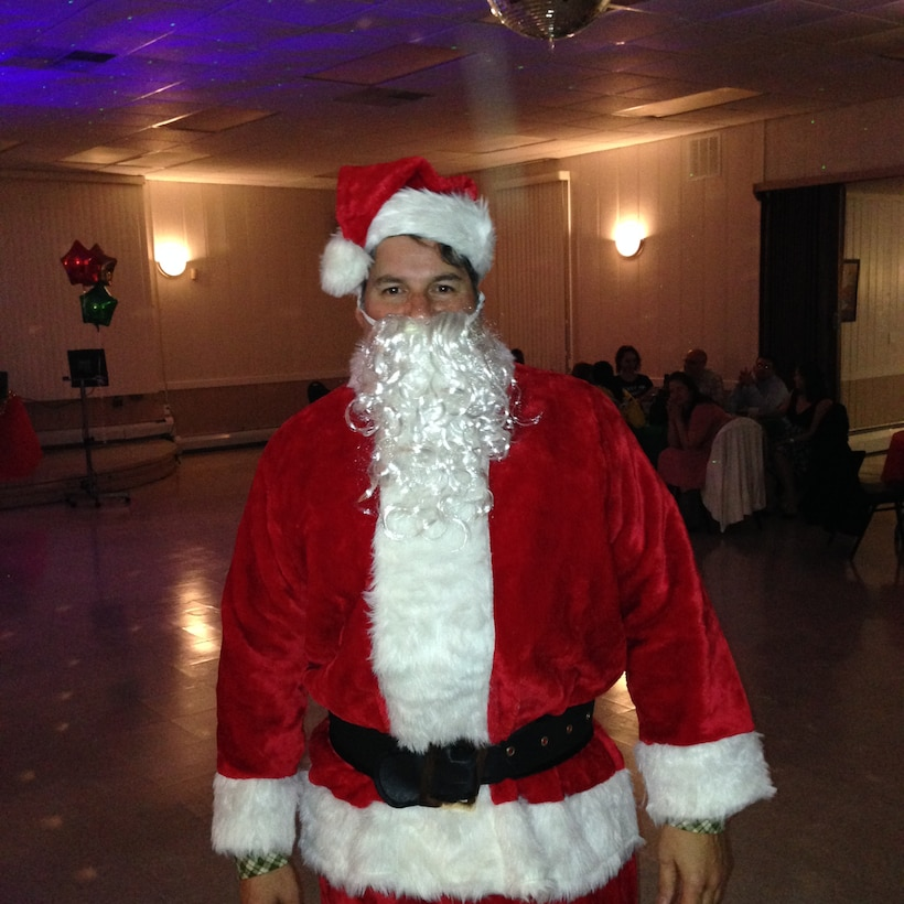 Col. John McKaye, the 16th Intelligence Squadron commander, dresses in a Santa suit during the squadrons holiday party on Nov. 14, 2015. (Courtesy photo)