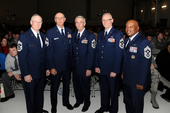 The five most recent command chief master sergeants of the 127th Wing gather at Selfridge Air National Guard Base during the annual awards ceremony at the base, Dec. 5, 2015. Pictured are Chief Master Sgts. (ret) Michael Dalton, Stephen Krajewski and Keith Edwards; and Chief Master Sgts. Robert Dobson and Tony Whitehead. During the ceremony, Whitehead replaced Dobson as the Wing's current command chief. (U.S. Air National Guard photo by Senior Airman Ryan Zeski)