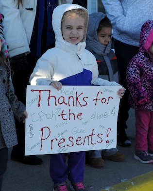 A child holds up a sign for Santa during the annual Angel Tree program at the Youth and Family Services Center in Rapid City, S.D., Dec. 17, 2015. The Angel Tree program is put on annually by the 28th Operations Group from Ellsworth Air Force Base. (U.S. Air Force photo by Airman 1st Class Denise M. Nevins/Released)