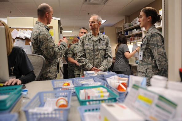 U.S. Air Force Col. Douglas Littlefield, 19th Medical Group commander, left, and Maj. Rachel Casey, 19th Medical Support Squadron pharmacy superintendent, brief U.S Air Force Surgeon General Lt. Gen. Mark Ediger on Dec. 16, 2015, at Little Rock Air Force Base, Ark. During his visit, he received a first-hand look at the role the 19th Medical Group plays in executing Little Rock AFB's mission and spoke with Airmen. (U.S. Air Force photo/Senior Airman Harry Brexel)