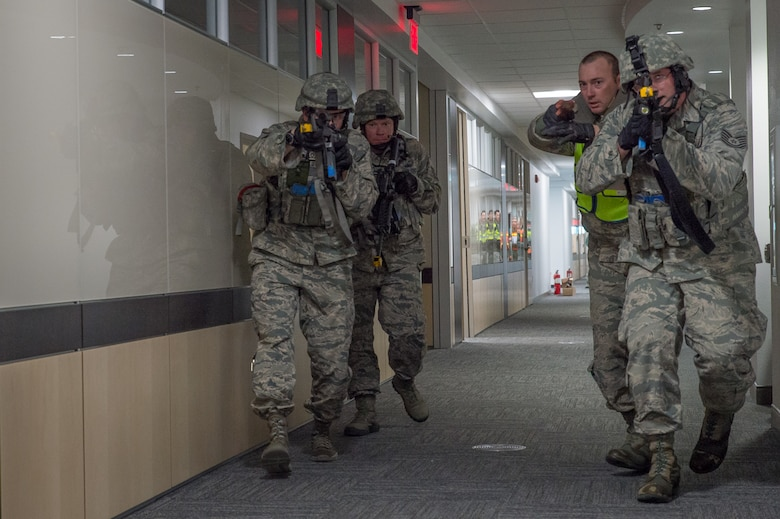 U.S. Air Force Airmen assigned to the 153rd Security Forces Squadron clear a room in the headquarters building Dec. 18, 2015 at Cheyenne Air National Guard base in Cheyenne, Wyoming. The Airmen sweep the building looking for additional gunmen as part of an active shooter exercise. The scenario was in support of memorandum sent by Secretary of the Air Force Deborah James to test lockdown and active shooter procedures in response to shootings in Chattanooga, Tenn. (U.S. Air National Guard photo by Master Sgt. Charles Delano)