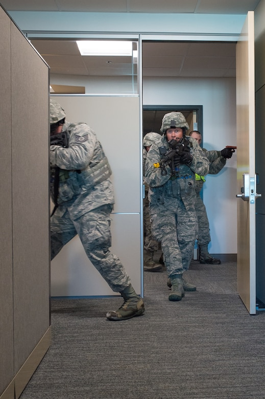 U.S. Air Force Tech. Sgt. Kenneth Paul clears a room in the 153rd Airlift Wing headquarters building Dec. 18, 2015 at Cheyenne Air National Guard base in Cheyenne, Wyoming. Paul and other security forces Airmen look for additional gunmen during an active shooter exercise. The scenario was in support of memorandum sent by Secretary of the Air Force Deborah James to test lockdown and active shooter procedures in response to shootings in Chattanooga, Tenn. (U.S. Air National Guard photo by Master Sgt. Charles Delano)