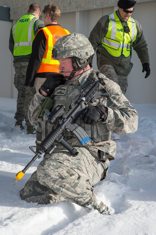U.S. Air Force Tech. Sgt. Kenneth Paul, 153rd Security Forces Squadron, communicates with the Base Defense Operations Center, Dec. 18, 2015 at Cheyenne Air National Guard base in Cheyenne, Wyoming. Paul and several security forces Airmen chased down and eliminated a gunman during an exercise in which an active shooter attempted to fatally wound as many people as possible before being captured or killed. The scenario was in support of memorandum sent by Secretary of the Air Force Deborah James to test lockdown and active shooter procedures in response to shootings in Chattanooga, Tenn. (U.S. Air National Guard photo by Master Sgt. Charles Delano)