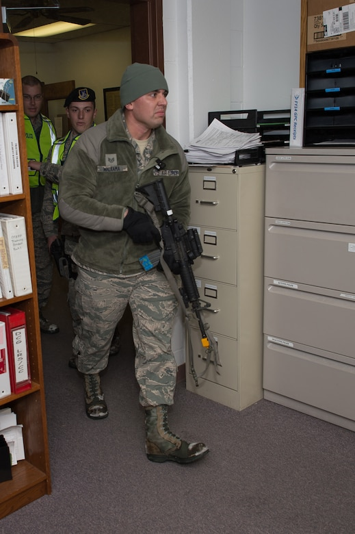 U.S. Air Force Staff Sgt. Chance Walkama, 153rd Security Forces Squadron, walks through a doorway, Dec. 18, 2015 at Cheyenne Air National Guard base in Cheyenne, Wyoming. Walkama portrayed a lone gunman during an active shooter exercise attempting to fatally wound as many people as possible before being captured or killed. The scenario was in support of memorandum sent by Secretary of the Air Force Deborah James to test lockdown and active shooter procedures in response to shootings in Chattanooga, Tenn. (U.S. Air National Guard photo by Master Sgt. Charles Delano)
