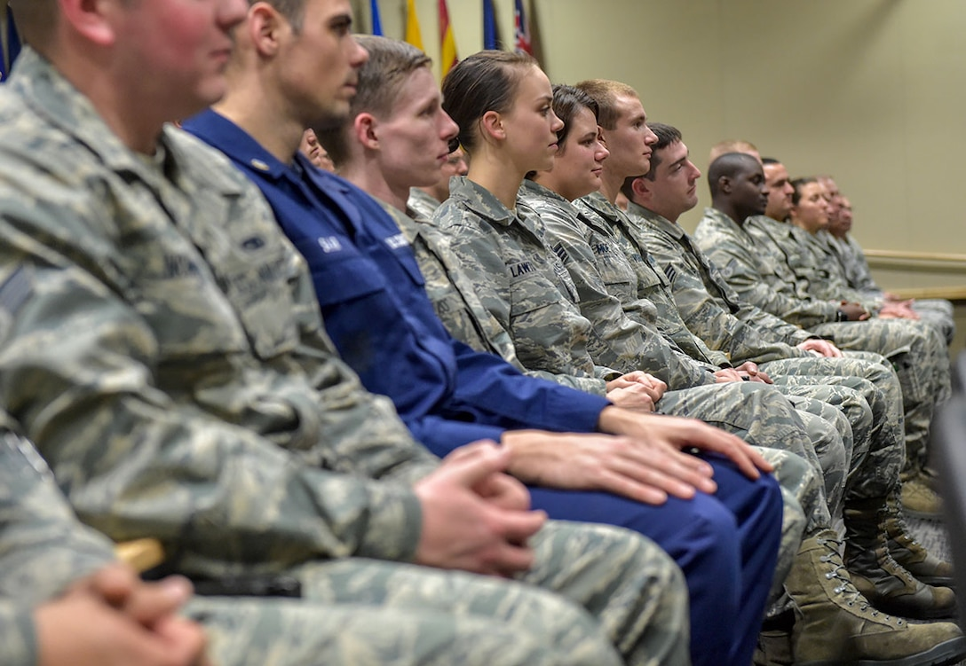 Service members at the Joint Base Elmendorf-Richardson Professional Military Education Center listen to a speaker Dec. 8. The PMEC's largest Airman Leadership School class ever graduates Friday. (U.S. Air Force photo/Justin Connaher)
