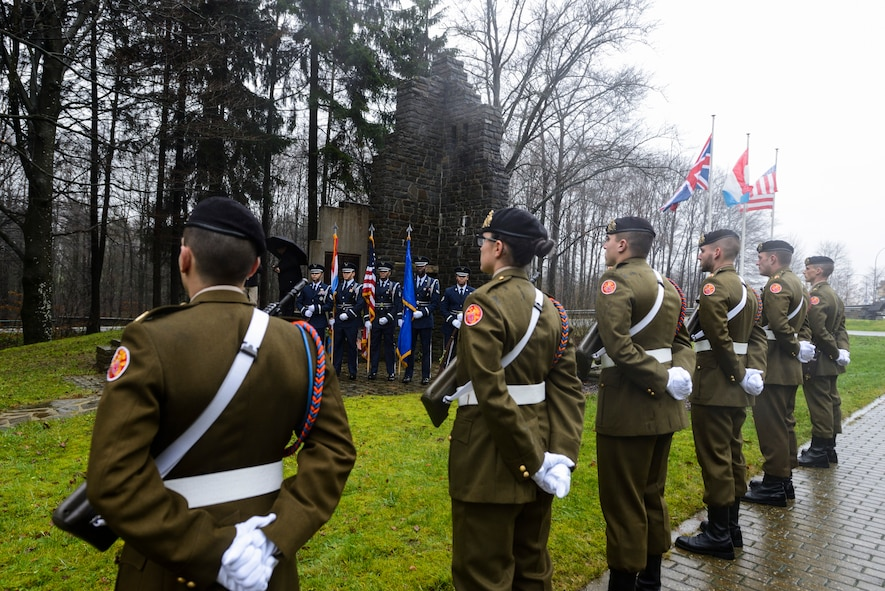 U.S. Air Force Honor Guardsmen assigned to the 52nd Fighter Wing and Luxembourg Army Honor Guard members participate in a Battle of the Bulge anniversary ceremony at the National Liberation Memorial in Schumanns Eck, Luxembourg, Dec. 16, 2015. The battle took place in parts of Belgium, France, Luxembourg and Germany beginning in the winter of 1944. (U.S. Air Force photo by Staff Sgt. Christopher Ruano/Released)