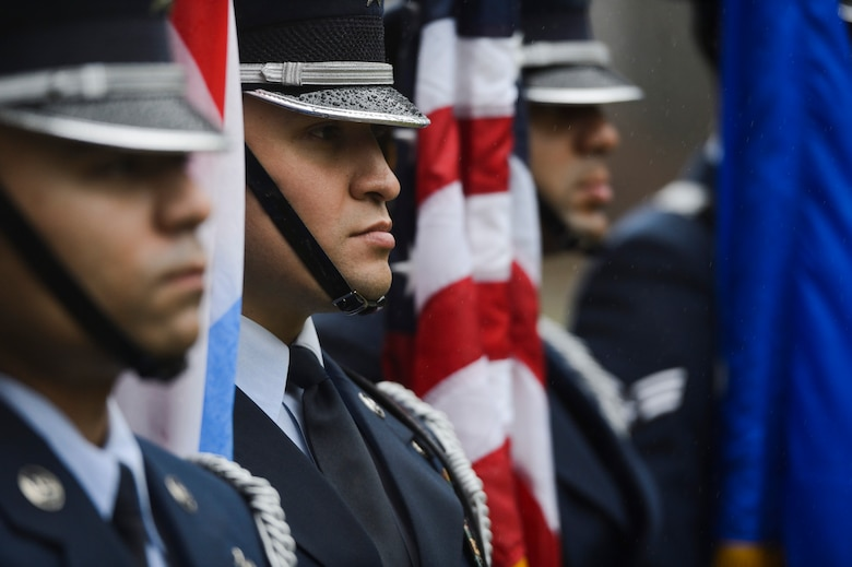 U.S. Air Force Honor Guardsmen, assigned to the 52nd Fighter Wing stand at attention during a Battle of the Bulge anniversary ceremony at the National Liberation Memorial in Schumanns Eck, Luxembourg, Dec. 16, 2015. The ceremony commemorated the 71st anniversary of the beginning of the battle which began on Dec. 16, 1944. (U.S. Air Force photo by Staff Sgt. Christopher Ruano/Released)