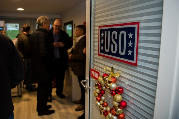 Spangdahlem community members visit inside the newly opened USO center at Spangdahlem Air Base, Germany, Dec. 16, 2015. More than 30 Airmen and community members gathered for the opening of the USO. The USO is located on the first floor of building 126. (U.S. Air Force photo by Airman 1st Class Luke Kitterman/Released)