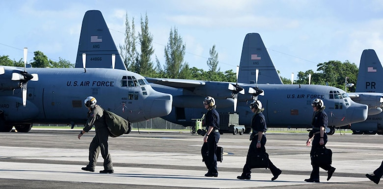 The 156th Airlift Wing, provides logistical and maintenance support to the Navy on Puerto Rico Air National Guard Base Muñiz during the week of Dec 5 thru 11, 2015. Two Navy C-2 cargo planes flew in from the USS George Washington Aircraft Carrier to drop off navy personnel, and pick up pre-ordered supplies and equipment for the vessel. The mission is to provide logistical support for the vessel's journey from San Diego, California to South America, ending its last leg in Norfolk, Virginia. (U.S. Air National Guard photo by Tech Sgt. Efrain Sanchez)