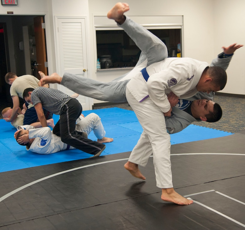 Senior Airman Justin Fisher throws Senior Airman Oscar Felix, both with the 71st Operations Support Squadron, to the ground during Brazilian Jiu Jitsu practice Nov. 19 at the Community Chapel Activities Center at Vance Air Force Base, Oklahoma. In class this throw was used to counter the attacker, Felix, who was grabbing or touching the upper body of the victim, Fisher. Jiu Jitsu, a form of martial arts, was bought to Vance nearly two years ago by Tech. Sgt. Tony Eclavea, a chaplain assistant with the 71st Flying Training Wing. (U.S. Air Force photo / Staff Sgt. Nancy Falcon)