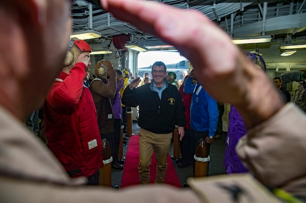 U.S. Defense Secretary Ash Carter arrives aboard the amphibious assault ship USS Kearsarge in the Arabian Gulf, Dec. 19, 2015. Carter has been on a weeklong middle east trip. The Kearsarge is the flagship for the Kearsarge Amphibious Ready Group and, with the embarked 26th Marine Expeditionary Unit, is deployed in support of maritime security operations and theater security cooperation efforts in the U.S. 5th Fleet area of operations. U.S. Navy photo by Petty Officer 3rd Class Tyler Preston