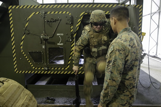 A Marine with 2nd Supply Battalion, 2nd Marine Logistics Group climbs out of a Humvee Egress Assistance Trainer simulator during a class at Marine Corps Base Camp Lejeune, N.C., Dec. 17, 2015. The HEAT class is designed to show Marines what to do if a vehicle rolls over during low visibility, no visibility, or experiences sideways or 180-degree rollovers.