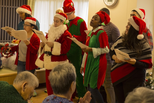 Volunteers from Marine Corps Air Station Iwakuni, Japan, sing Christmas carols to residents at the Vita Nursing Home in Iwakuni, Dec. 16, 2015. The chapel coordinated this community event as an opportunity to experience Japanese culture, give back to the local community and strengthen the bond between the U.S. and Japan.