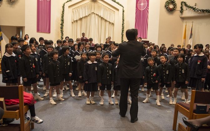 Japanese students from Migama Elementary School and Kawashimo Junior High School sing a holiday carol during the annual holiday concert at Marine Memorial Chapel at Marine Corps Air Station Iwakuni, Japan, Dec. 8, 2015. Traditionally, M.C. Perry School invites local Japanese schools to participate in the concert affording the students the opportunity to interact with one another.