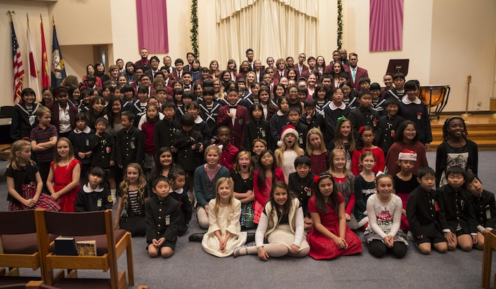 Matthew C. Perry School students and Japanese students pose for a photo at the annual holiday concert at Marine Memorial Chapel at Marine Corps Air Station Iwakuni, Japan, Dec. 8, 2015. The American and Japanese students prepared and sang a number of holiday songs in both Japanese and English.