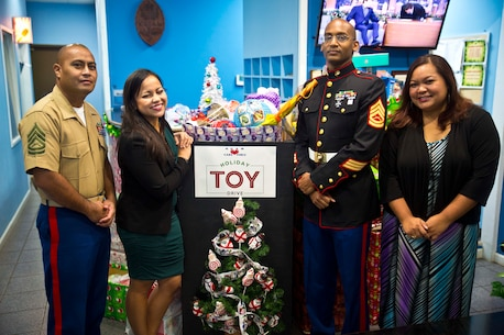 KUAM contributed this years Toys for Tots toy drive.