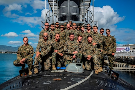 Marines and Sailors with Company A, 1st Reconnaissance Battalion, 1st Marine Division, pose for a photo atop of the USS Mississippi, a Virginia Class Block 5 submarine aboard Joint Base Pearl Harbor-Hickam, Hawaii, Nov. 17, 2015. Company A toured the ship as part of a one-day Special Operations Forces capabilities training event, where they learned about lock-out submarine insertions. (U.S. Marine Corps Photo by Sgt. Tony Simmons)