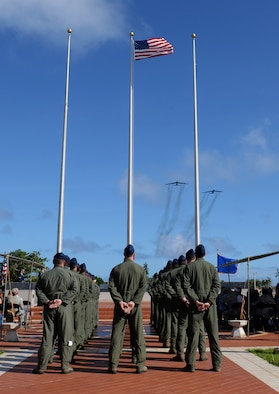 Aviators from the 23rd Expeditionary Bomb Squadron stand at parade rest as two B-52 Stratofortresses conduct a flyover during the Linebacker II Remembrance Ceremony Dec. 18, 2015, at Andersen Air Force Base, Guam. During Operation Linebacker II, more than 700 B-52 bombing campaigns were conducted out of Andersen. (U.S. Air Force photo/Staff Sgt. Benjamin Gonsier)
