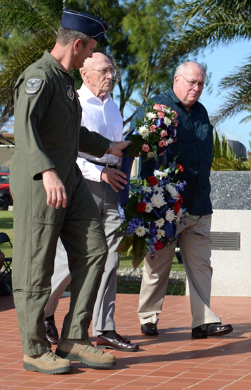 Brig. Gen. Andrew Toth, 36th Wing commander, Retired Maj. Gen. Thomas Rew and Dr. James Willbanks, director of the Department of Military History at U.S. Army Command and General Staff College, carry a wreath during the Linebacker II remembrance ceremony Dec. 18, 2015, at Andersen Air Force Base, Guam. The ceremony honored the sacrifices service members made and observed the 43rd anniversary of Operation Linebacker II, which led to the end of the Vietnam War. (U.S. Air Force photo/Staff Sgt. Benjamin Gonsier)