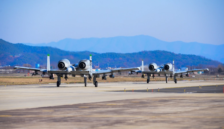 A-10 Thunderbolt IIs taxi on the flightline after a forward air control training mission during Buddy Wing 15-8 at Osan Air Base, Republic of Korea, Dec. 17, 2015. U.S. Air Force and ROKAF pilots performed FAC missions simultaneously to ensure interoperability. (U.S. Air Force photo/Airman 1st Class Dillian Bamman)