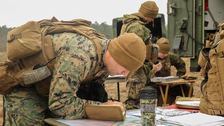First Lt. Chris Christeson, a platoon commander with 1st Battalion, 10th Marine Regiment, plans for the next fire mission during a limited objective experiment at Marine Corps Base Camp Lejeune, N.C., Dec. 8, 2015. The unit partnered with the Marine Corps Warfighting Laboratory and 3rd Battalion, 6th Marine Regiment, to test direct fire missions from an artillery platoon while supporting an infantry company landing team.