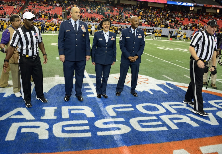 Air Force Reserve Command leadership take the field for the coin toss at the Air Force Reserve Celebration Bowl Dec 19 in Atlanta. The game featured the champions from the SWAC and MEAC in a winner take all the championship of Historicall Black Colleges and Universities. North Carolina A&T defeated Alcorn State 41-34 in a exciting game. (Air Force photo/Master Sgt Chance Babin)