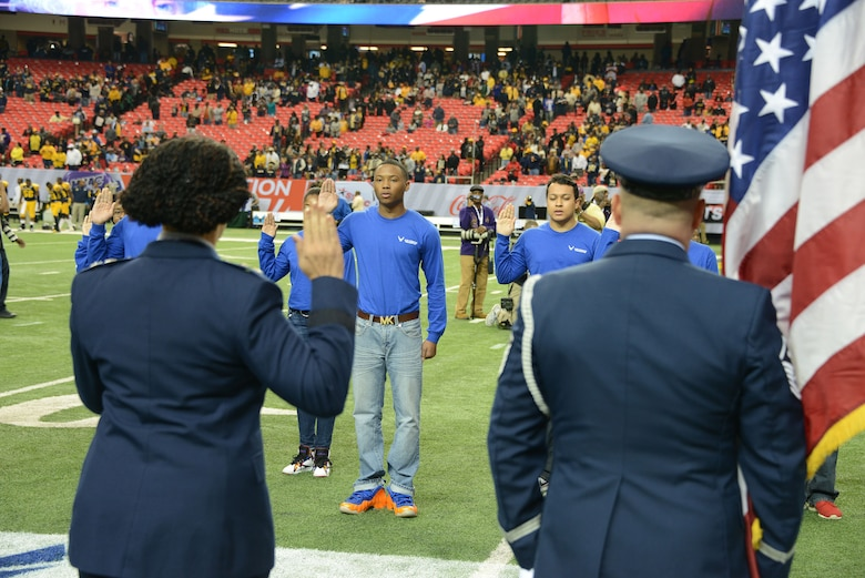 A mass enlistment was held on the field just before kickoff as 12 of the newest Air Force Reservists joined the ranks at the Air Force Reserve Celebration Bowl. The enlistment was conducted by Maj Gen Stayce D. Harris, 22nd Air Force commander, Dobbins Air Reserve Base. (Air Force photo/Master Sgt. Chance Babin)