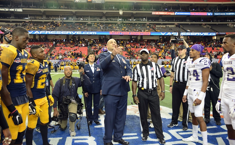 Maj Gen Richard S. Haddad, Air Force Reserve Command vice commander, flips the coin prior to the kickoff of the Air Force Reserve Celebration Bowl at the Georgia Dome in Atlanta Dec. 19. (Air Force photo/Master Sgt. Chance Baibn)