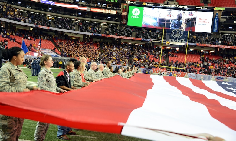 A team of 60 Air Force Reservist's and family members hold the American flag during the national anthem at the Air Force Reserve Celebration Bowl Dec. 19 at the Georgia Dome. (Air Force photo/Master Sgt. Chance Babin)