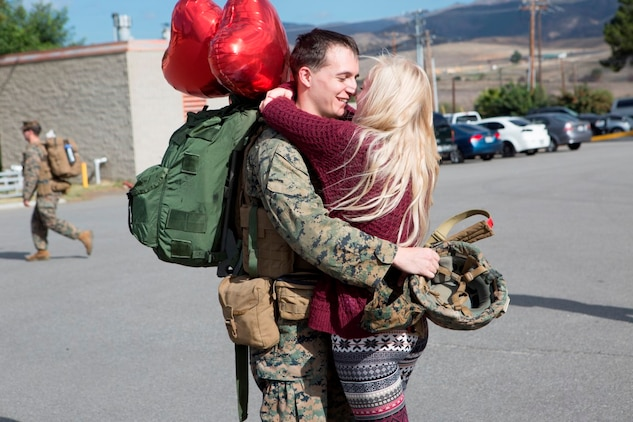 Cpl. Dominique A. Sparacino is welcomed home by his loving wife, Victoria Sparacino, upon return from a seven-month deployment with the 15th Marine Expeditionary Unit at Marine Corps Base Camp Pendleton, California. While deployed, the 15th MEU participated in more than 15 different theater security cooperation or bi-lateral exercises including combined arms and desert survival training with French forces in Djibouti, the Malaysia-US Amphibious Exercise, Combined Afloat Readiness and Training in Brunei, and more than 12 subject matter expert exchanges with partner nations throughout the Middle East. Sparacino is an infantryman with Lima Company, 3rd Battalion, 1st Marine Regiment, 1st Marine Division, I Marine Expeditionary Force. (Marine Corps photo by Cpl. April L. Price/ Released)