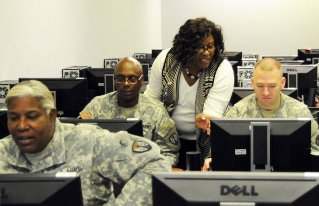 Shirley Burke-Mitchell provides Corps of Engineers Financial Management System training to Reserve Soldiers training at the U.S. Army Engineering and Support Center, Huntsville. A cadre of Huntsville Center acquisition specialists with expertise in a variety of procurement areas volunteered to provide the training the Soldiers require prior to their deployment in 2016.