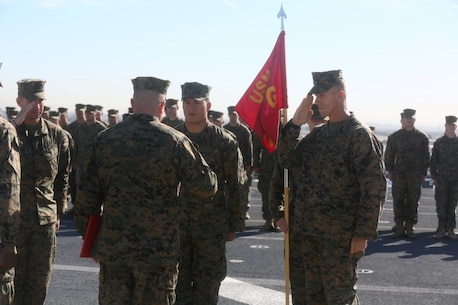 John Tey, center, a U.S. Marine infantryman with the 13th Marine Expeditionary Unit, stands at attention while two of his mentors salute their commander before Tey's promotion at his ceremony during Certification Exercise, Dec. 3, 2015. Corporal is the first noncommissioned officer rank in the Marine Corps, and comes with increased authority as well as increased responsibility. (U.S. Marine Corps photo by Sgt. Paris Capers/RELEASED)