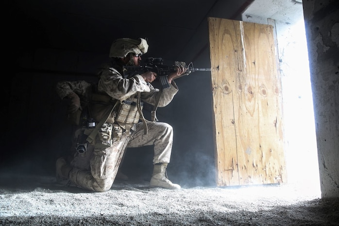 A Marine provides suppressing fire during the mechanized assault portion of a Marine Corps Combat Readiness Exercise at Marine Corps Air Ground Combat Center Twentynine Palms, Calif., Dec. 3, 2015. The purpose of a MCCRE is to evaluate Marines' collective performance in specific mission requirements that will prepare them for their upcoming deployment rotation. The Marine is with 2nd Battalion, 7th Marine Regiment, 1st Marine Division. (U.S. Marine Corps photo by Lance Cpl. Devan K. Gowans)