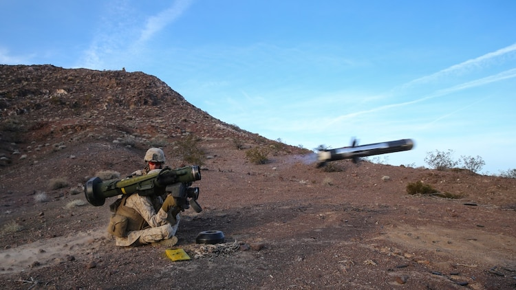 Marines fire an FGM-148 Javelin anti-tank missile during the company supported, live-fire assault portion of a Marine Corps Combat Readiness Exercise at Marine Corps Air Ground Combat Center Twentynine Palms, Calif., Dec. 7, 2015. The purpose of a MCCRE is to evaluate Marines' collective performance in specific mission requirements that will prepare them for their upcoming deployment rotation. The Marines are with 2nd Battalion, 7th Marine Regiment, 1st Marine Division. (U.S. Marine Corps photo by Lance Cpl. Devan K. Gowans)